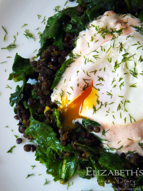 Poached egg with spiced puy lentils and asparagus kale