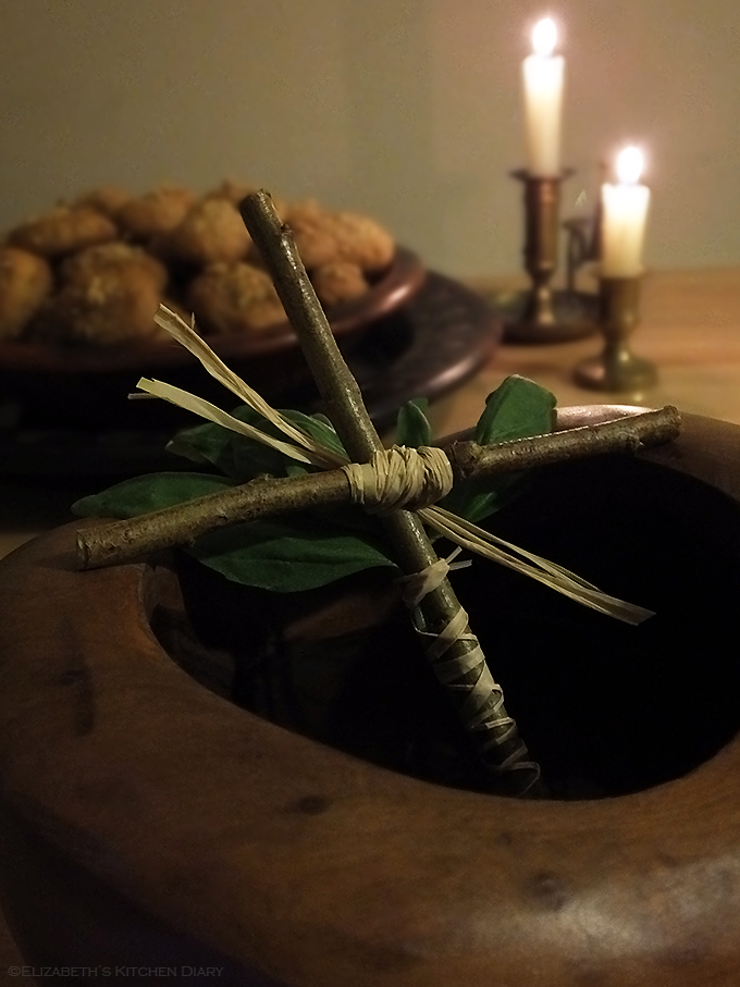 wooden cross with basil