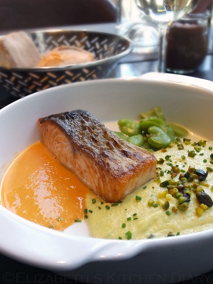 Salmon a la plancha with a creamy polenta with pistachios and tomato butter