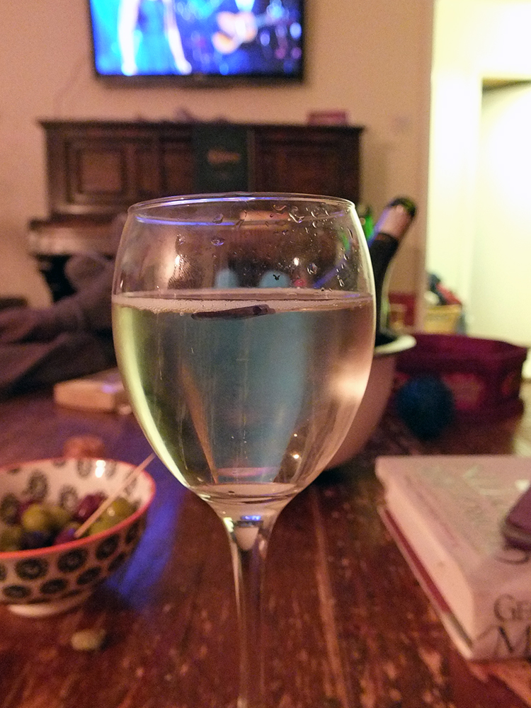 Glass of prosecco with 125 ml line marked