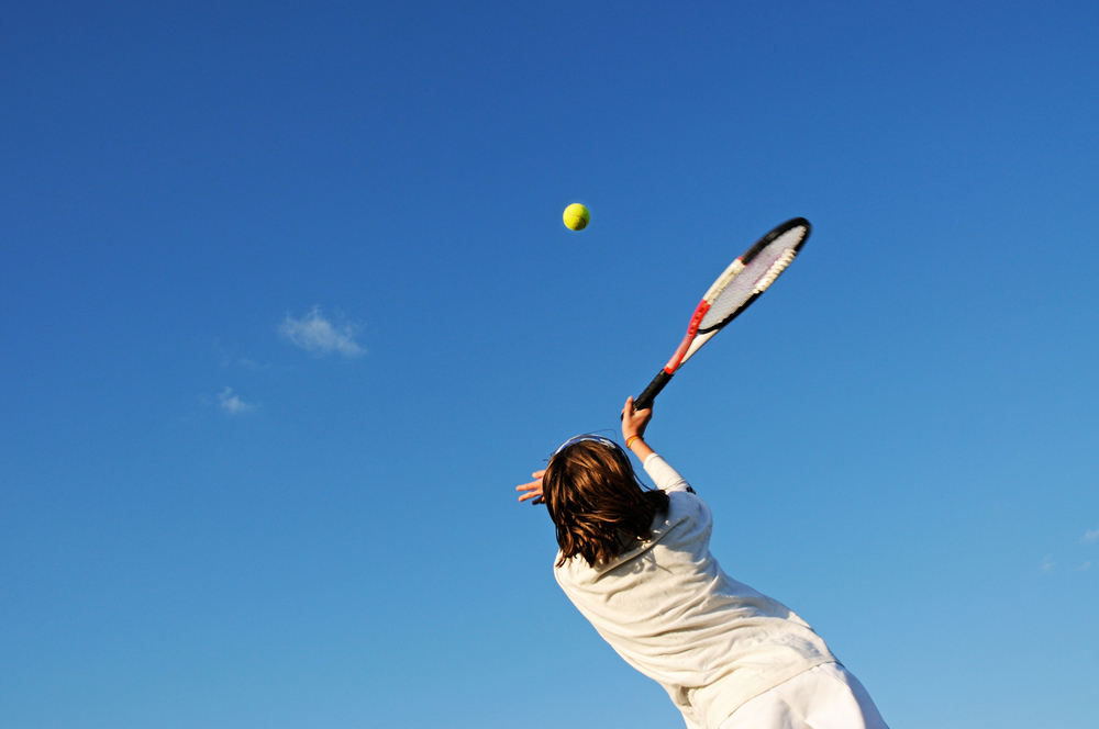 Girl playing Tennis, image courtesy of Shutterstock