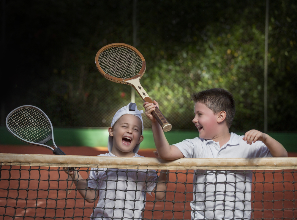 Boys playing Tennis, image courtesy of Shutterstock
