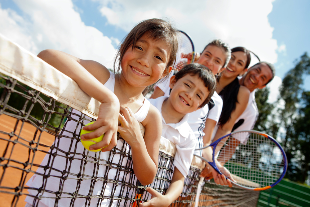 Family playing Tennis, image courtesy of Shutterstock