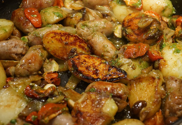 Sausages with semi dried tomatoes, potatoes and pesto by Onions & Paper