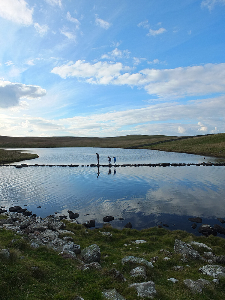 Stone causeway across the loch of Houlland, Eshaness, Shetland