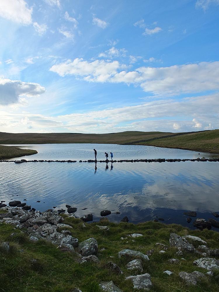 Stone causeway across the loch of Houlland, Eshaness, Shetland