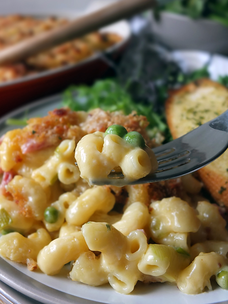 Three cheese macaroni & cheese with bacon, leeks and peas