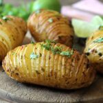Hasselback Potatoes with Chilli and Lime Butter by Veggie Desserts