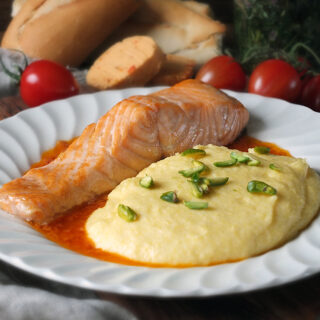 Grilled Salmon with Creamy Polenta with Pistachios and Tomato Butter