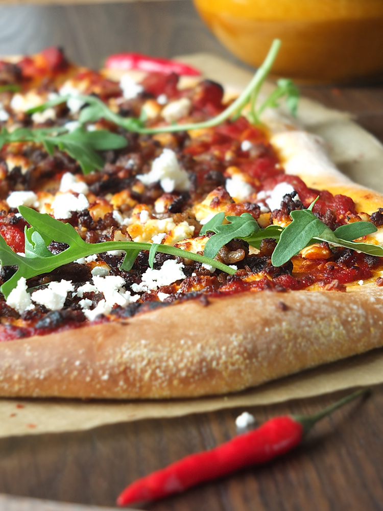 Spicy Lamb Pizza with Feta, Rocket and a Yogurt Drizzle