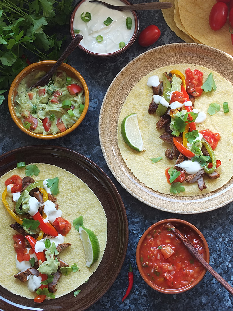 this triple lamb fajitas recipe for a crowd is perfect if you're entertaining guests. Part Mexican fajita, part Middle Eastern kebab and part over the top extravagant, this recipe can be ready in just two hours! #fajita #lamb #kebab