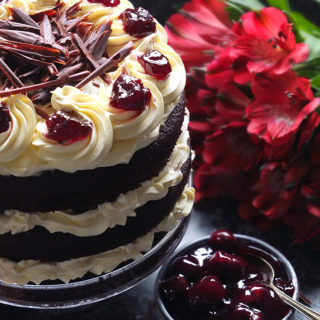 Layers of rich chocolate cake drizzled with cherry brandy sandwiched together with sweetened whipped cream and black cherry conserve. The cake is finished with more cream and some dark chocolate curls.