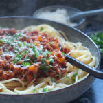 Lamb bolognese with linguine and Parmesan on top