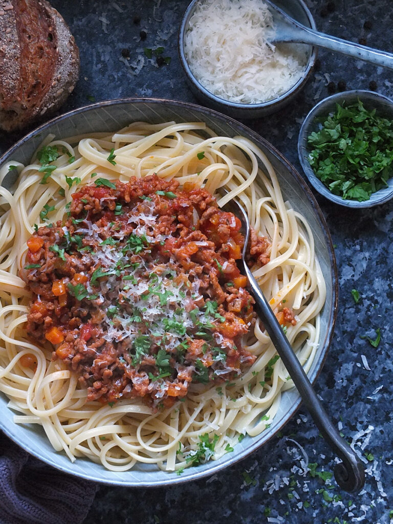 bolognese with linguine and Parmesan on top