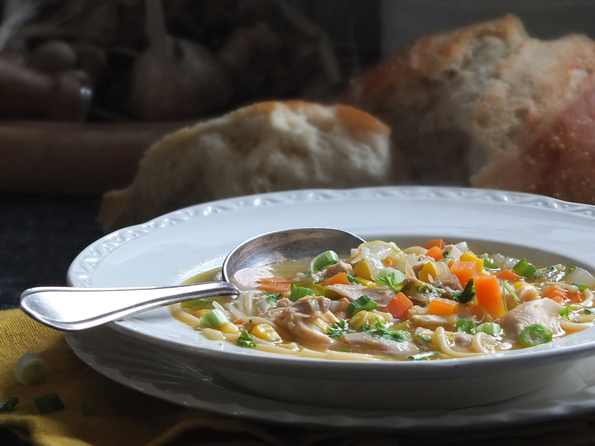 Chicken noodle soup with spoon image