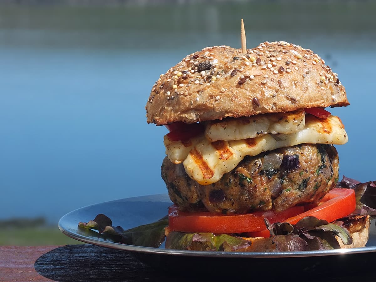 image of grilled lamb burger in bun with fiery chilli halloumi