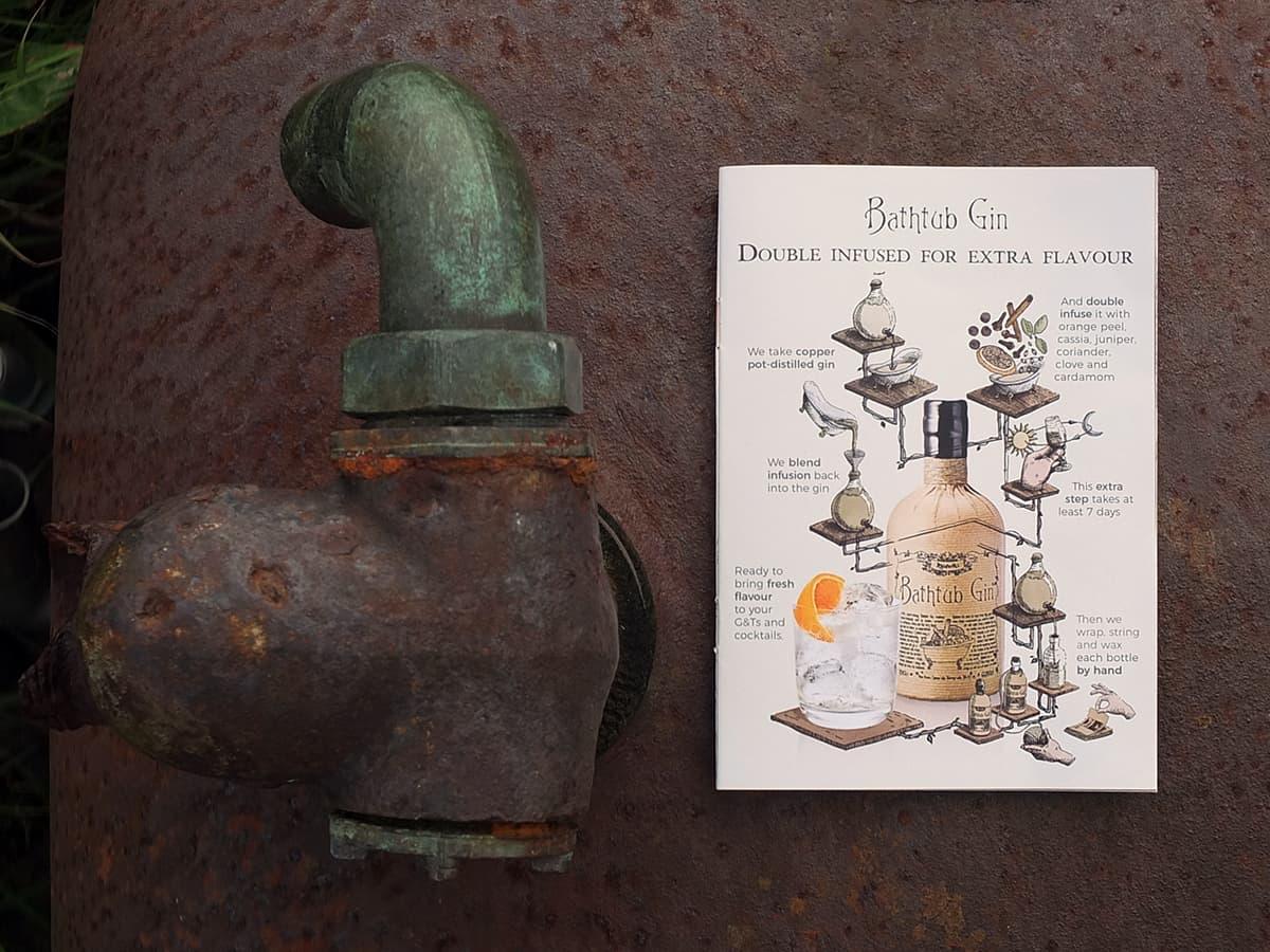 photo of Bathtub gin leaflet on top of a rusty old bathtub
