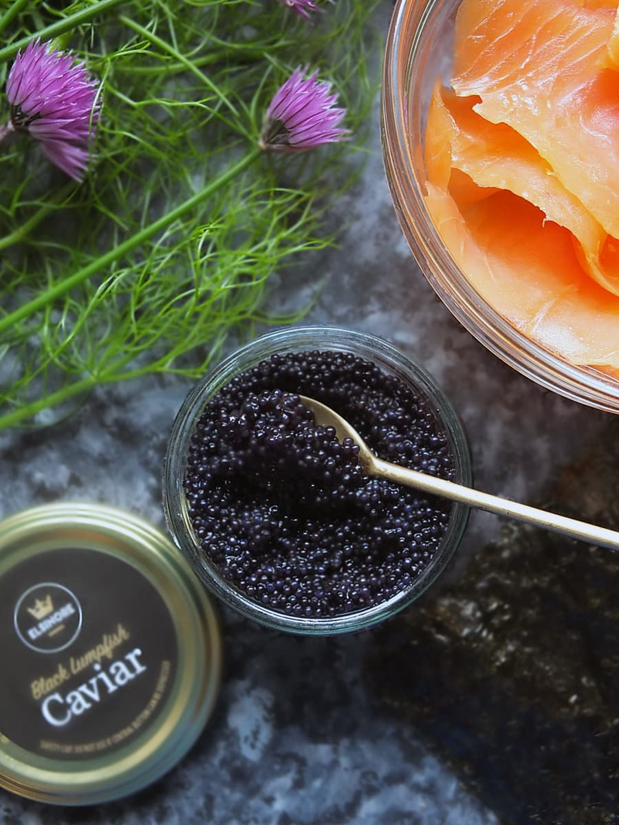 photo of black lumpfish caviar in bowl with spoon
