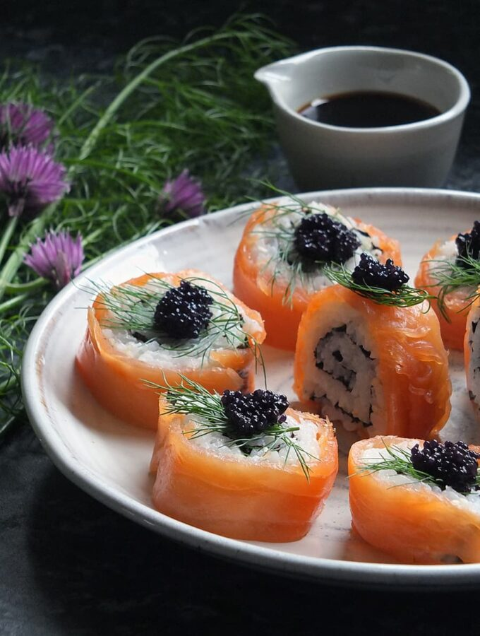 Image of smoked salmon uramaki sushi garnished with lumpfish caviar