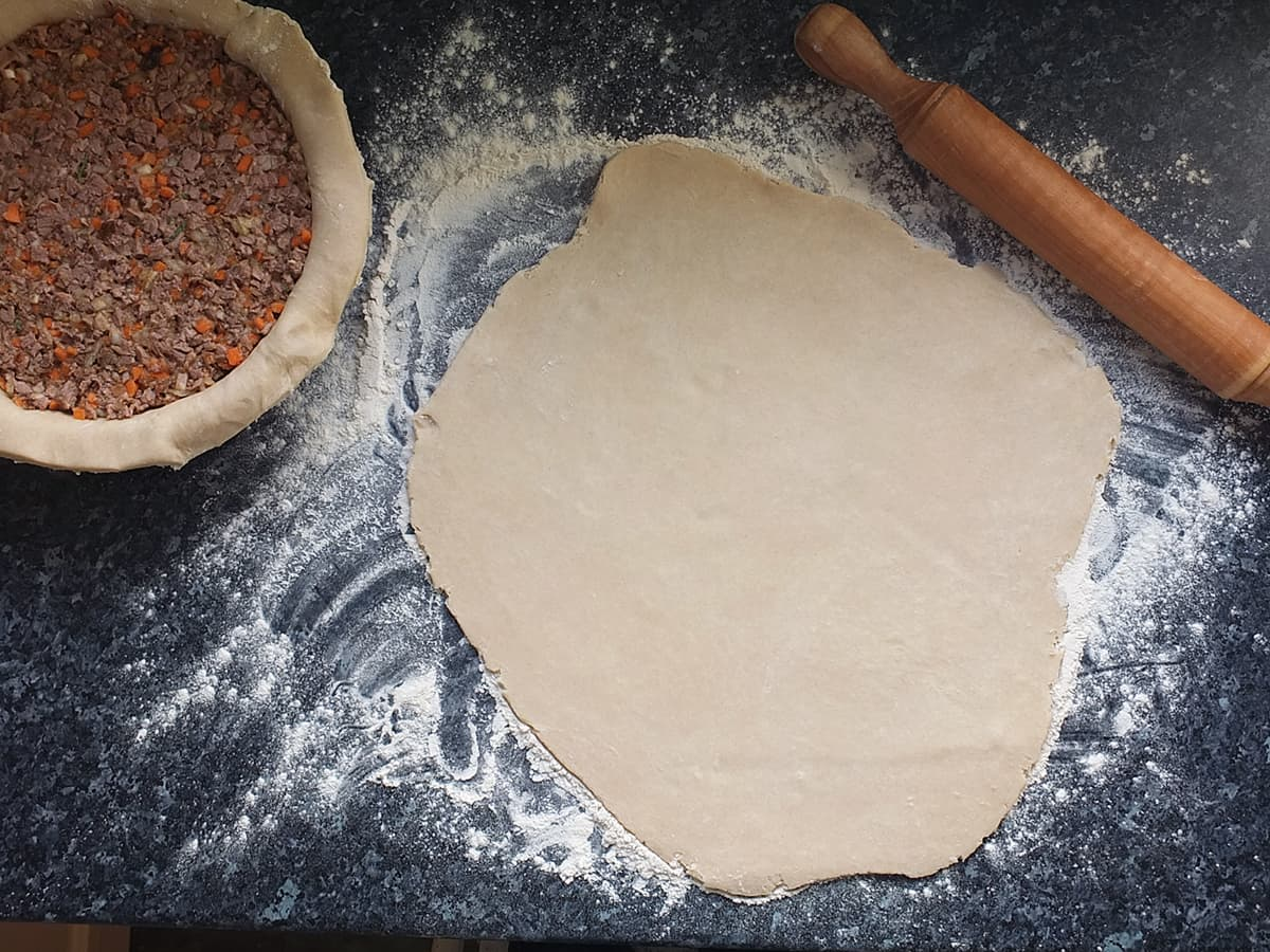 a rolled out top pie crust with rolling pin image