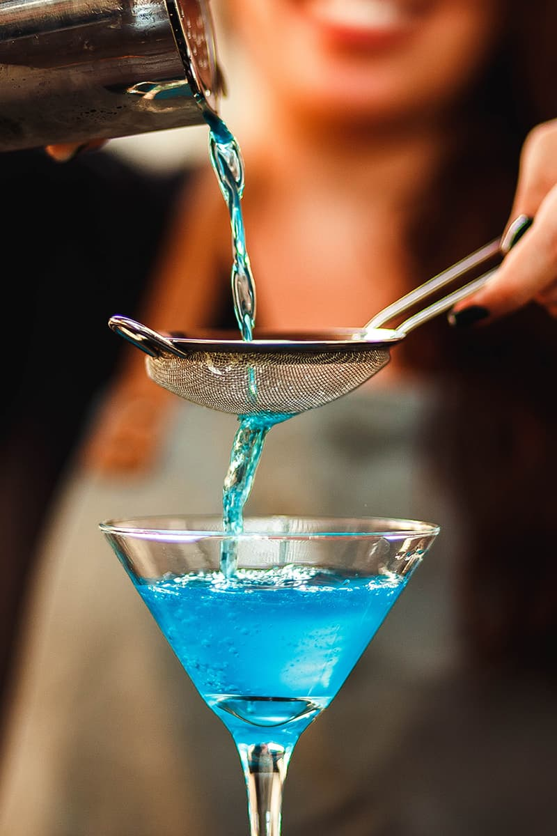 image of pouring blue cocktail recipes from Unsplash