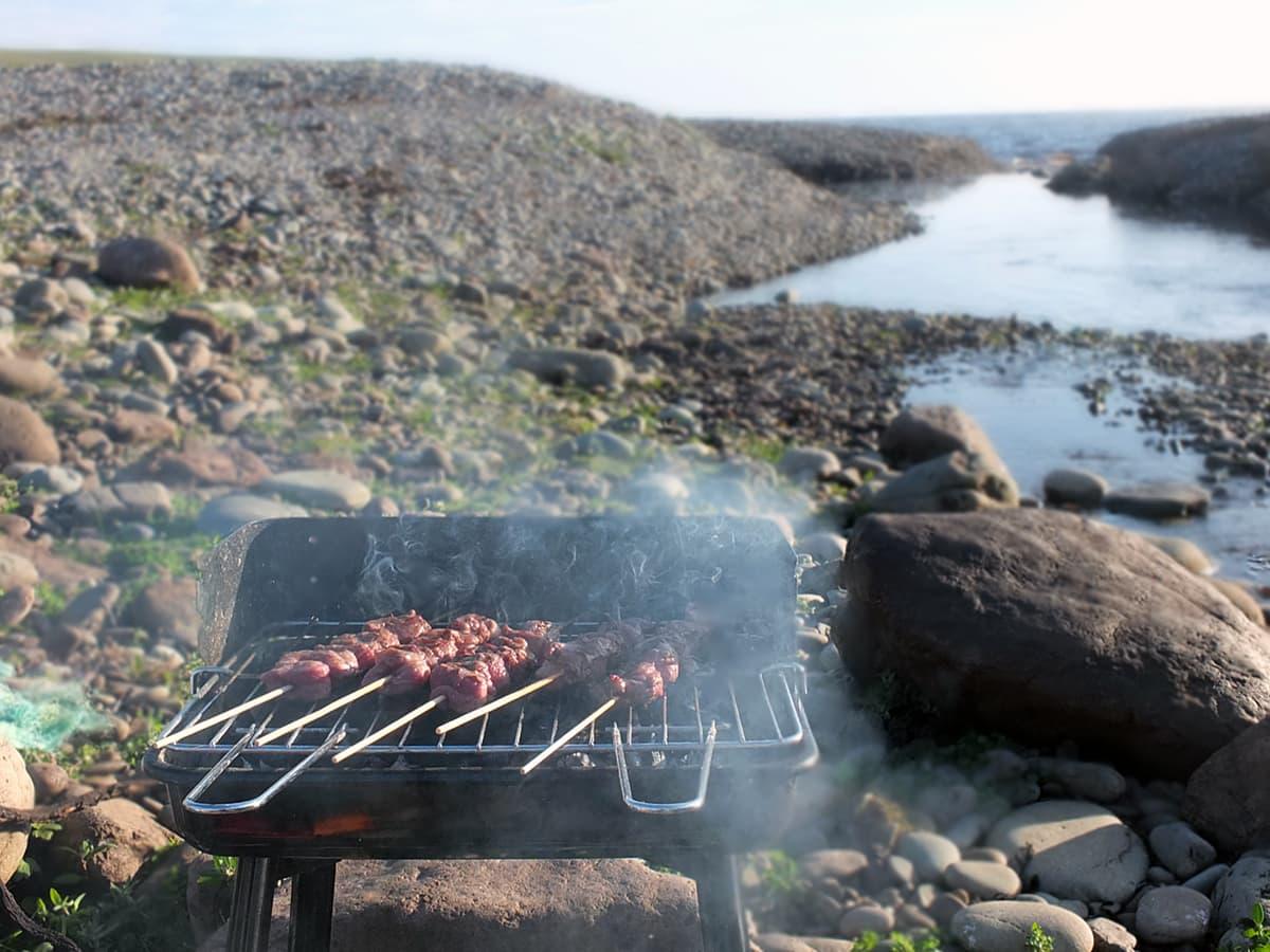BBQ lamb on the beach image