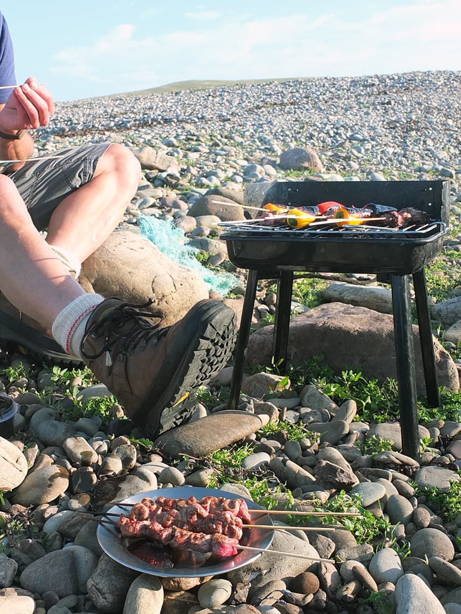 Eating BBQ lamb on the beach image