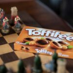 Photograph of Toffifee unopened package on a chess board