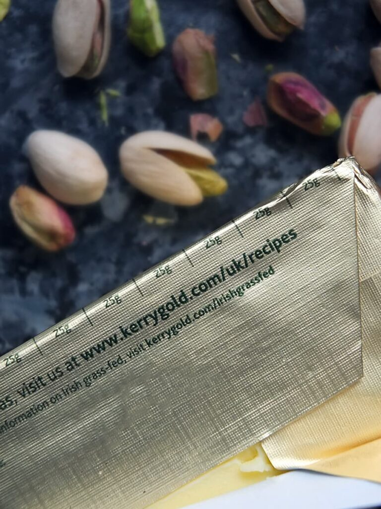 Image of the back of the Kerrygold packaging showing the 25 gram lines.