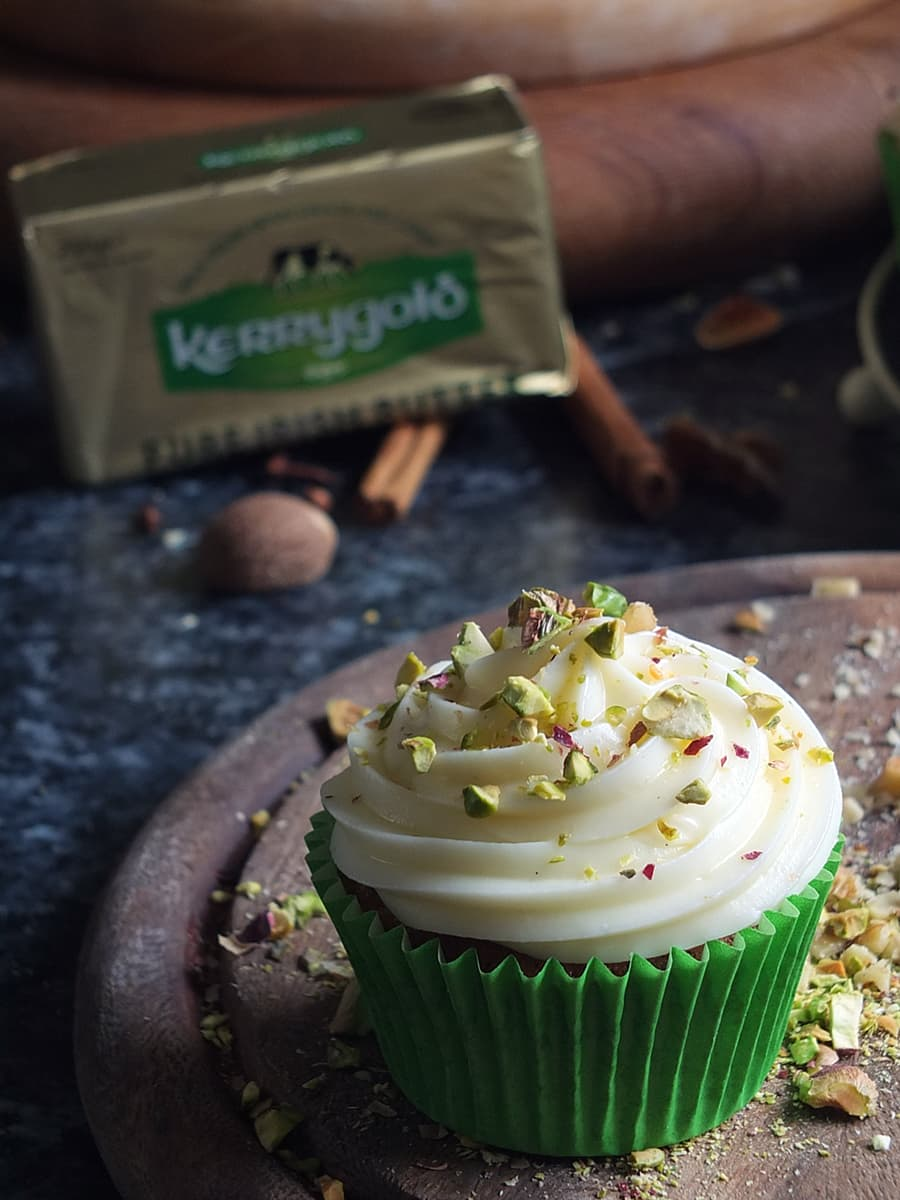Spiced Zucchini Cupcakes recipe image with Kerrygold butter package in the background.