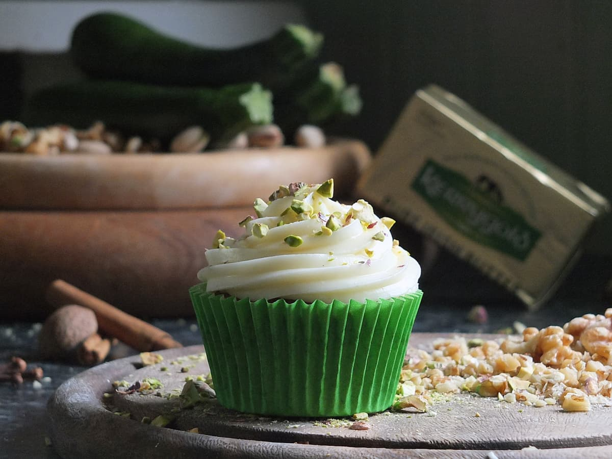 Spiced courgette cupcake with Kerrygold butter in background