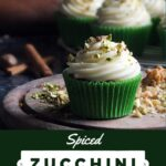Pinterest pin image of spiced zucchini cupcakes with cream cheese frosting.