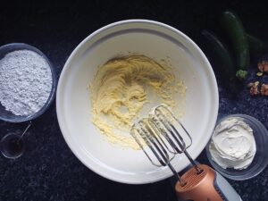 Image of room temperature butter beaten until smooth in a bowl.