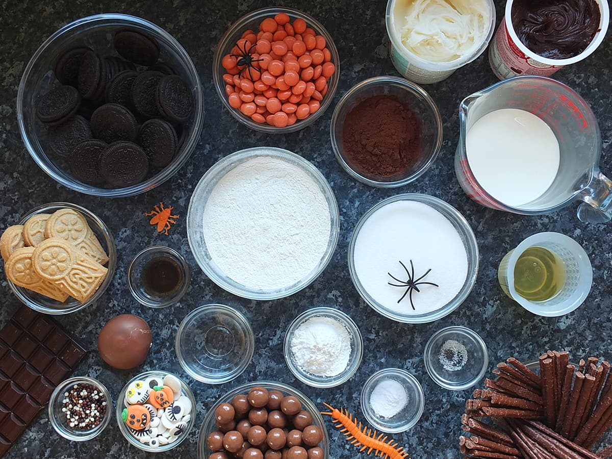 Top down image of all the ingredients needed to make an egg free chocolate Halloween graveyard cake.