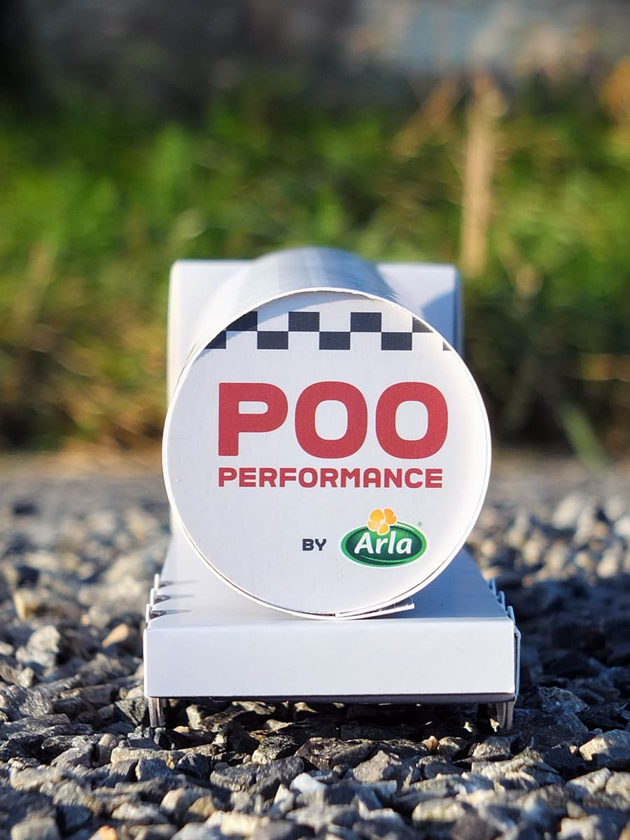 Image of the back of the poo powered milk tanker with the words Poo performance by Arla.