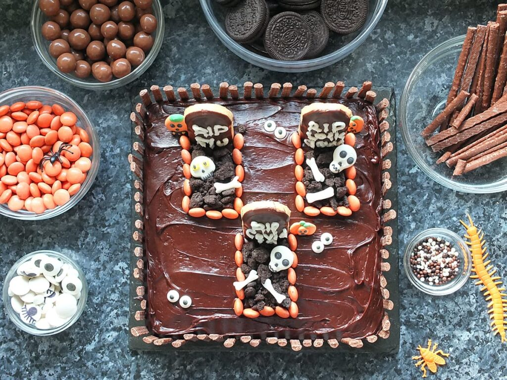Top down image of finished Halloween graveyard cake.