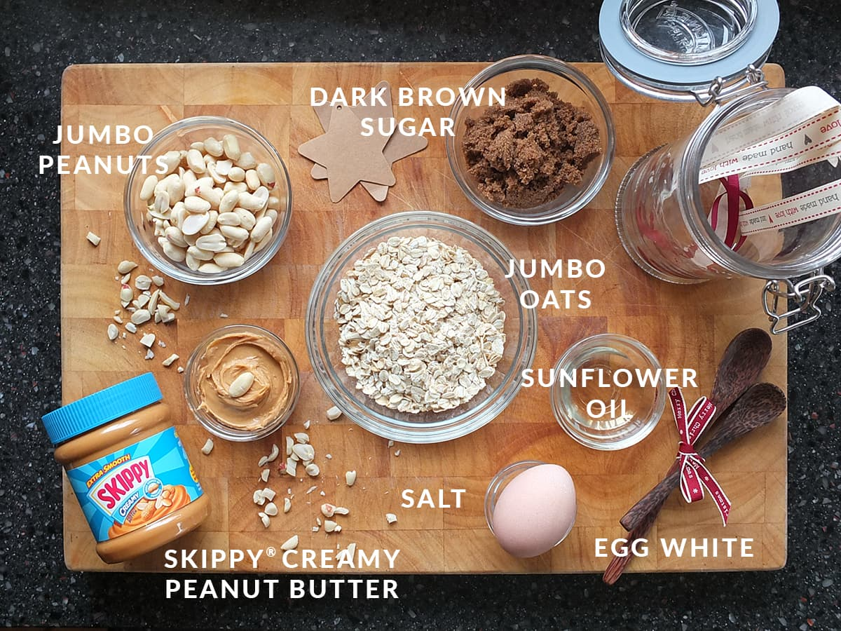 Top down image of all the ingredients needed to make peanut butter granola clusters.