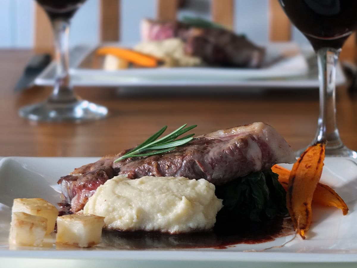 Image of lamb rump steaks with red wine jus.