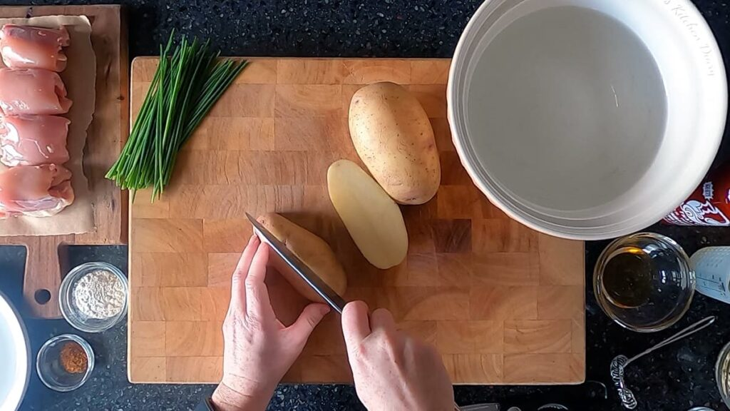 Top down image showing potato being cut into 8ths.