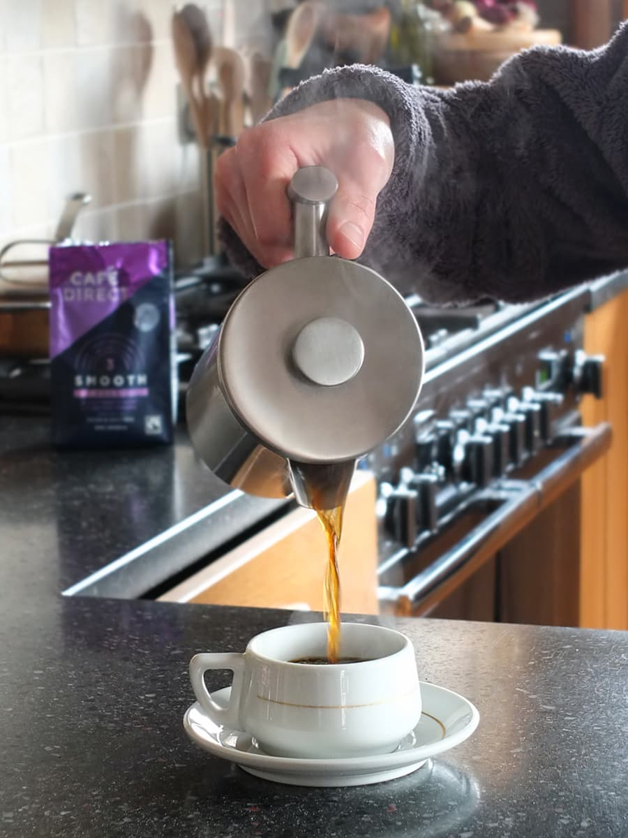 Image of man pouring coffee from a cafetiere.