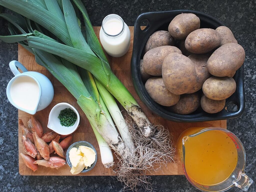 Top down image of all the ingredients needed for this recipe. The leeks were freshly harvested from Turrifield and still have soil on their roots.