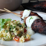 Mediterranean-inspired BBQ Koftas, Couscous Salad and Baharat Yogurt Dip