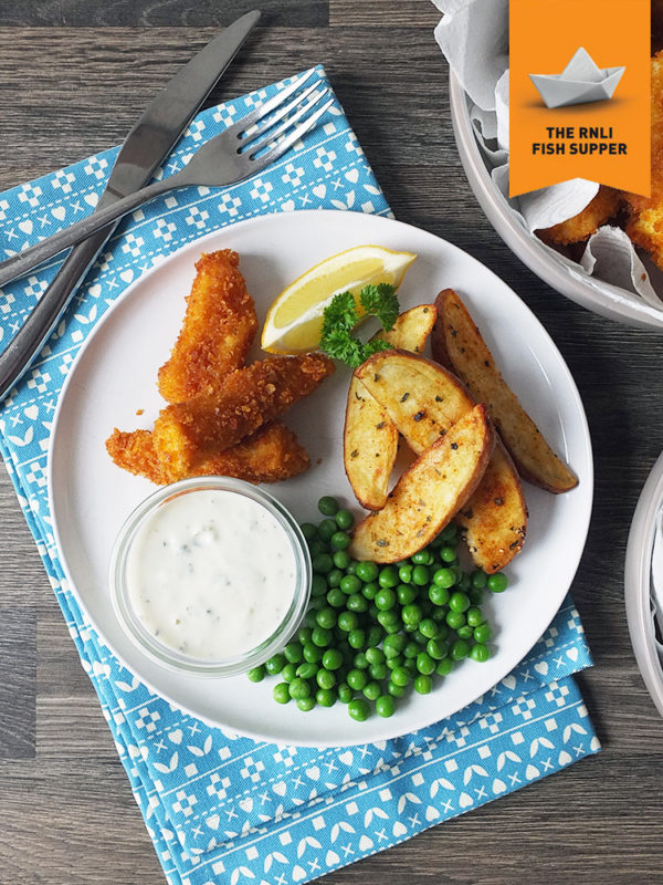 Homemade fish fingers with paprika-spiked potato wedges and homemade tartare sauce.