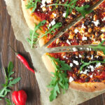 Spicy Lamb Pizza with Feta, Rocket & Yogurt Drizzle