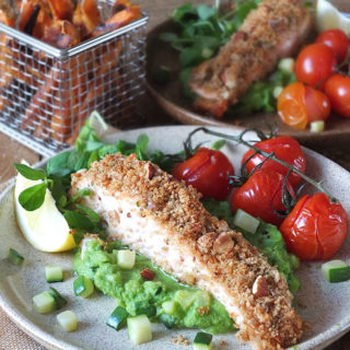 Baked nut-crusted salmon with pea puree & crispy sweet potato fries