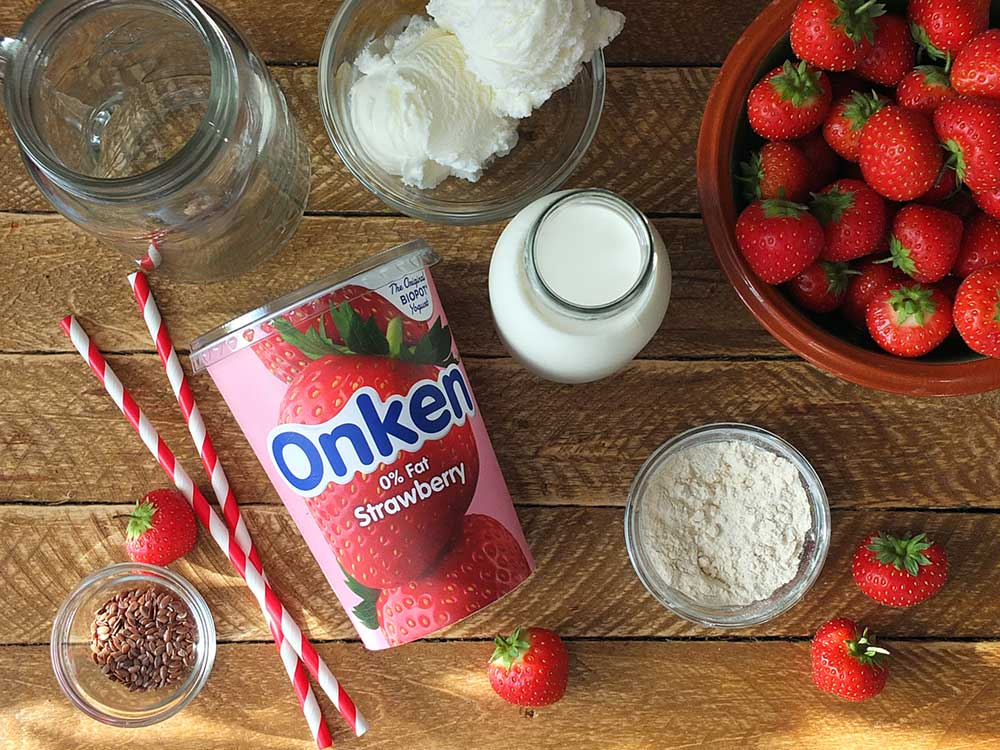 Ingredients for a strawberry post workout protein shake