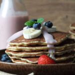 Oatmeal pancakes with a strawberry yogurt-maple syrup drizzle