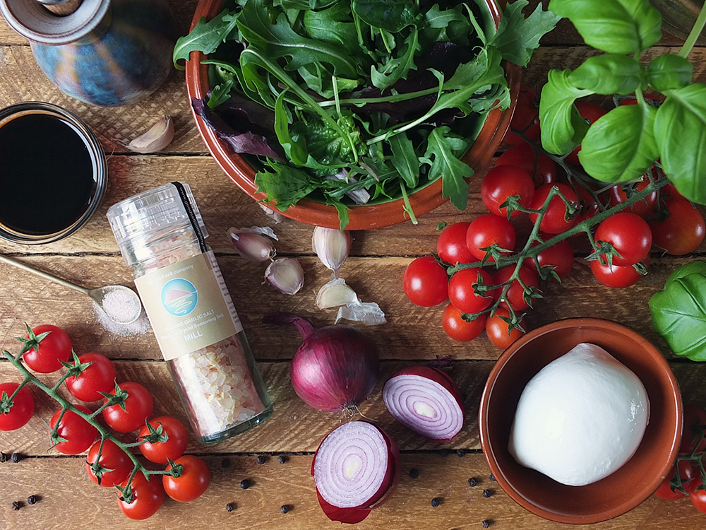Ingredients for tomato and mozzarella salad with Himalayan pink salt
