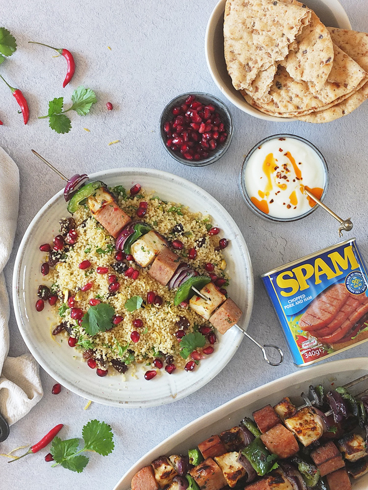 This SPAM® BBQ kebab recipe is super easy to whip up for any last minute BBQs you might be hosting this summer. Cubes of squeaky Halloumi cheese marinaded in chilli, parsley, cumin and coriander are threaded onto skewers with red onion, green pepper and sizzling SPAM®. #bbq #pork #kebab